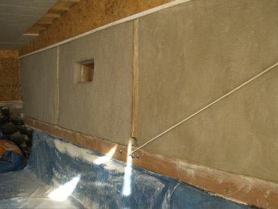 Two Coats Of Lime Render, Not Yet Fully Dry. Below, The Finished Wall